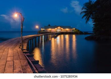 Wooden warf leading to a floating house, Hatta island, Maluku, Indonesia