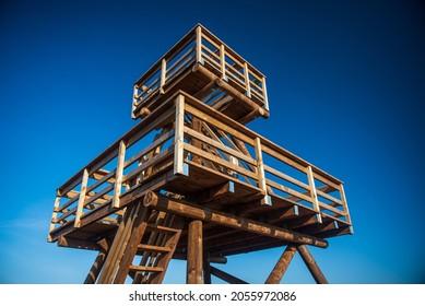 Wooden watching tower in Vasenieki marsh, Latvia. Sunny evening.