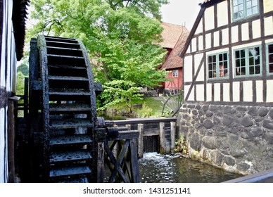 A wooden water wheel  and half-timbered house in Den Gamle By (The Old Town), an open-air town museum located in the Aarhus Botanical Gardens, in central Aarhus, Denmark.
