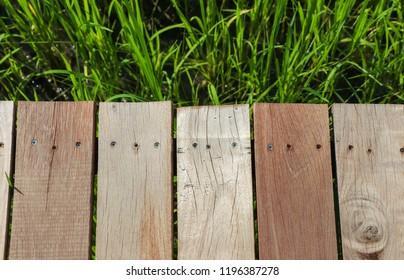 Wooden way on field