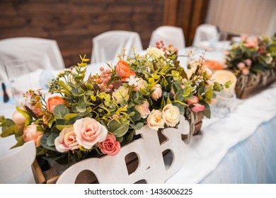 wooden wedding decor whith flowers where is written love