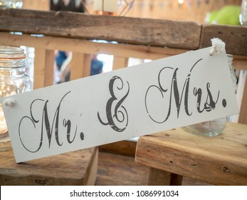 A wooden wedding decoration saying Mr & Mrs at a wedding venue
