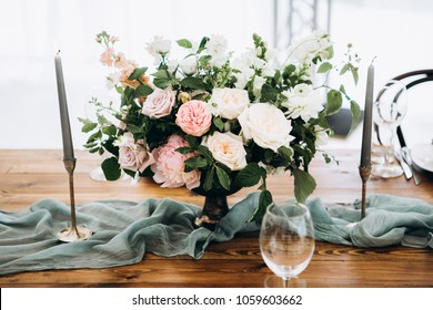 Wooden wedding table setting with bouquet
