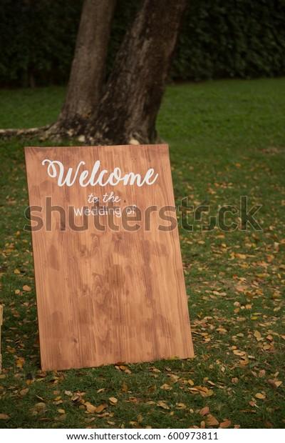 Wooden Welcome Sign at Wedding in Garden
