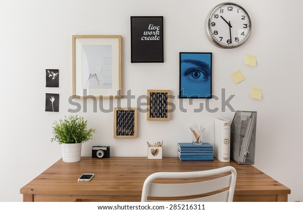 Wooden well arranged desk prepared to work