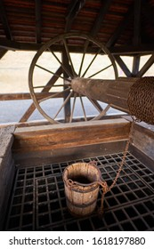 Wooden well with pulley and bucket