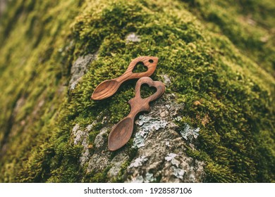 Wooden welsh love spoon on moss background with selective focus.