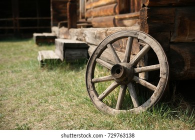Wooden wheel at an old village house.