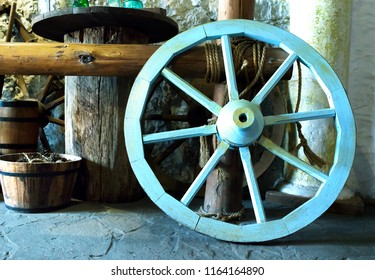 Wooden wheel in the stable