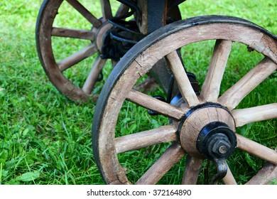 Wooden wheels of the retro village cart