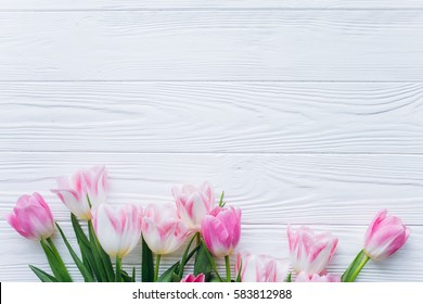 Wooden white background and pink tulips. Conception holiday, March 8, Mother's Day.