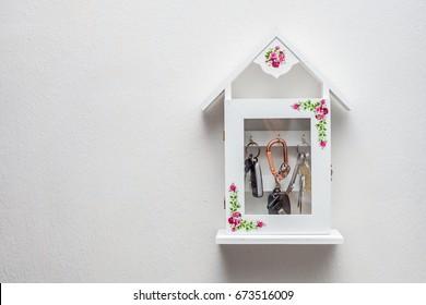 Wooden white Key Holder House  on white wall