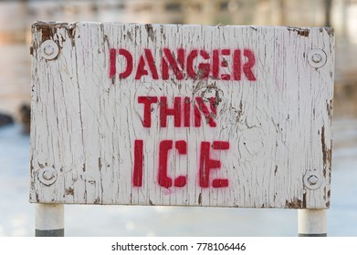 wooden white and red painted danger thin ice sige