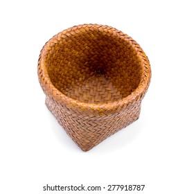 Wooden wicker basket over white background
