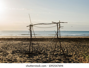 wooden wild structureon the beach at sunrise