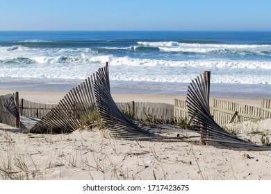 wooden wind shields on a beach