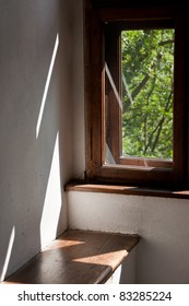 Wooden window detail with natural light passing through