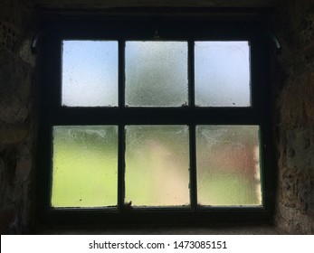 wooden window frame in barn stone wooden moody thoughtful obscured glass