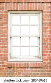 Wooden window on brick background