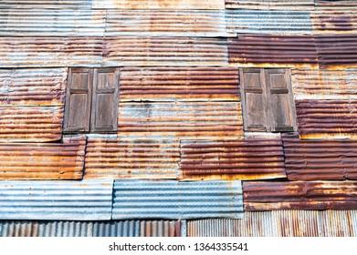Wooden window on the galvanized iron wall