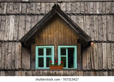 Wooden window on a wooden roof in Soca (Trenta) Valley, Slovenia.