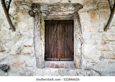 Wooden window in a rock facade