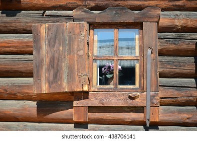 The wooden window with shutter. Old log house