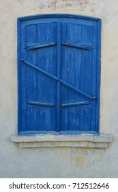 Wooden window shutters. The facade of houses.