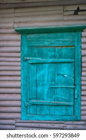 Wooden window shutters in old country house - carved window. Siberia, Altai.
