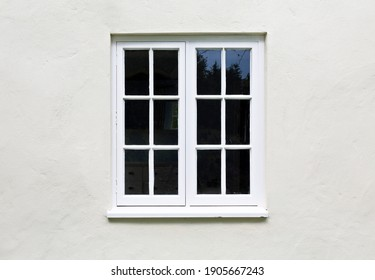 Wooden windows and sill on a home exterior. Cottage windows, UK