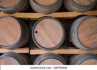 Wooden Wine Barrel Stacked in Wine-Vault