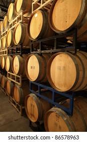 wooden wine barrels in a wine cellar