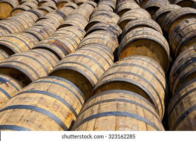 Wooden wine barrels in Glenora Distillery in Nova Scotia, Canada