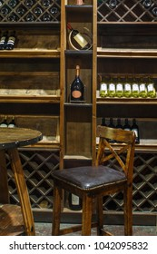 wooden wine room in store, hardwood table and bar stool, wooden wine chiller cabinet