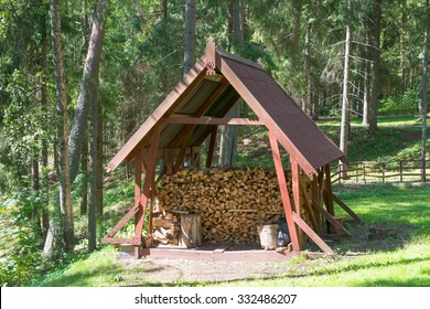Wooden woodshed with neatly arranged chopped firewood