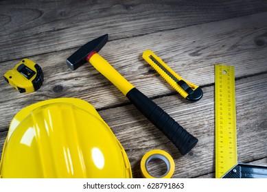 constructor wooden working desktop worker equipment.. top view, place for typography