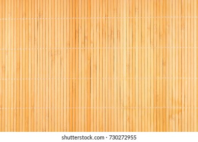 Wooden yellow bamboo mat texture abstract background.