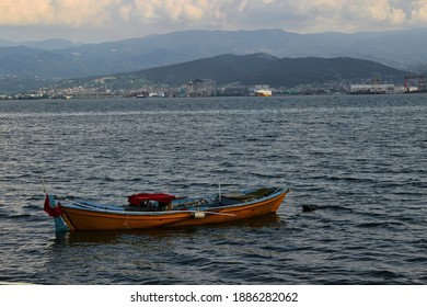 wooden yellow boat on the water of a small port in kocaeli, Turkey