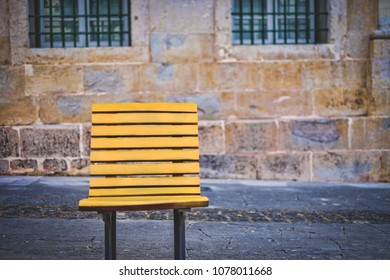 Wooden Yellow chair on street