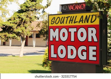 WOODHAVEN, MI-OCTOBER, 2015:  Sign for an old roadside motel with a glimpse of the 1950's era rooms in the background.  Motels like these were popular until chain motels began to take over the market.