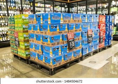 Woodland, CA/USA 08/16/2019 Pile with boxes of assorted brand beers for sale in a supermarket aisle