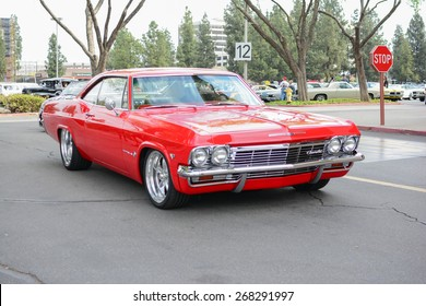 Woodland Hills, CA - Abril 5, 2015: Chevrolet Impala classic car on display at the Supercar Sunday Pre-1973 Muscle car event.