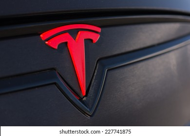Woodland Hills, CA - November 2, 2014: Close-up of Tesla Logo at the Supercar Sunday Electric Vehicles in Woodland Hills, CA.