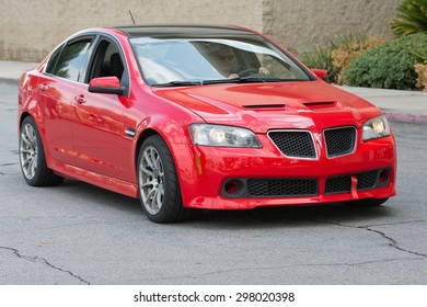 Woodland Hills, CA, USA - July 19, 2015:  Red Pontiac G8 car on display at the Supercar Sunday car event.
