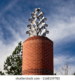 The Woodlands TX USA - Jan. 25, 2018  -  Steel Pine Cone on Red Brick Column