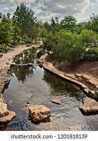 The Woodlands TX USA - June 5, 2018  -  Walkway along a Stream in The Woodlands TX