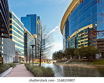 The Woodlands TX USA - May 22, 2018  -   Waterway with Glass Buildings in The Woodlands TX