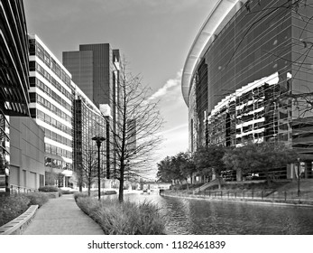 The Woodlands TX USA - May 22, 2018  -   Waterway with Glass Buildings in The Woodlands TX in B&W