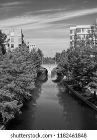The Woodlands TX USA - May 22, 2018  -  Waterway with Bridge in The Woodlands TX on a Summer Day in B&W