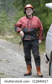 A woodman working in the forest, Sweden.